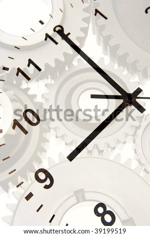 Hands on clock pointing to nine o'clock over gears.