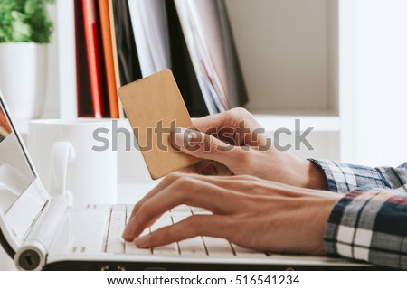 Shutterstock hands on computer keyboard with credit card, online shopping