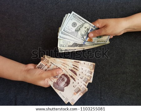 hands on currency exchange, mexican bills and dollar banknotes