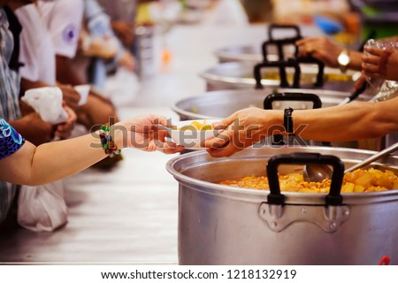 Hands-on food of the hungry is the hope of poverty : concept of homelessness #1218132919