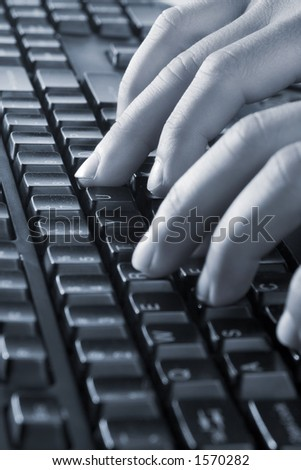 Hands on keyboard, blue color overall