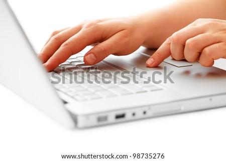 hands on laptop keyboard #98735276
