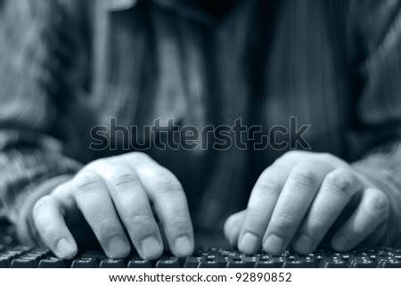 Hands on the keyboard - abstract computer background.