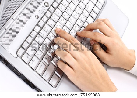 Hands on the laptop keyboard. Isolated on white background