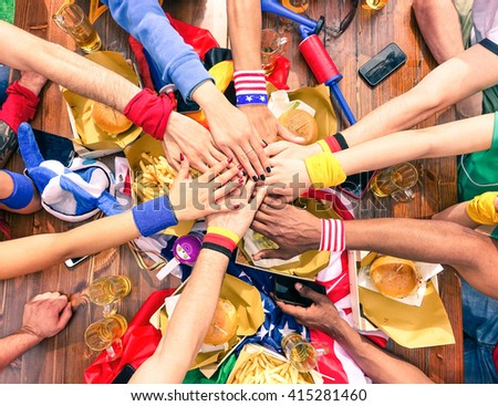 Hands on top each other sport fans party view from above at cafe bar restaurant -   Multiracial group of soccer supporter peace deal meeting - International team work and fun together in joyful moment