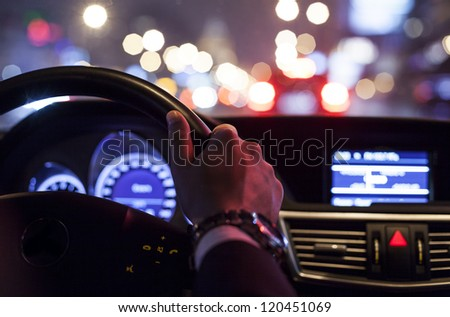 hands on wheel and city nightlife