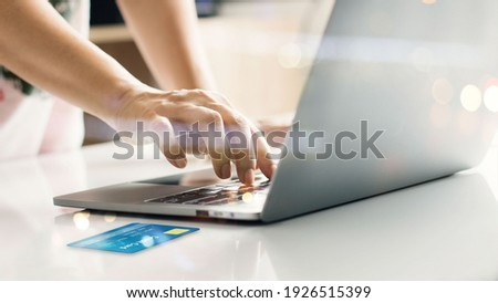Hands online shopping with credit card on laptop. Raising of e commerce develop secure payment processing service and enable customer more convenient to pay internet banking. Financial technology. Stock foto ©