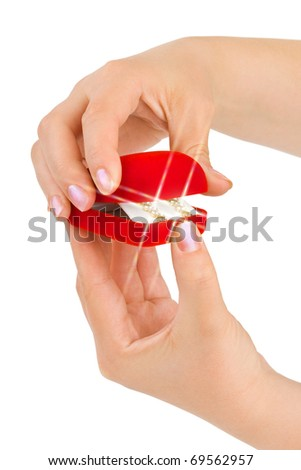 Hands opening gift and flare isolated on white background