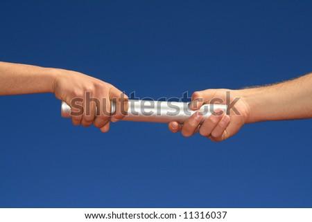 stock photo : hands passing the baton