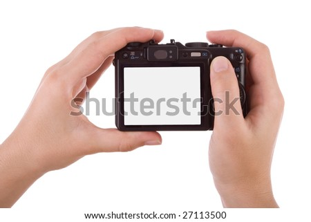 Hands photographic with a digital camera isolated on white