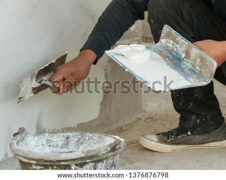 Hands Plasterer at work. Application of the plaster on the wall #1376876798