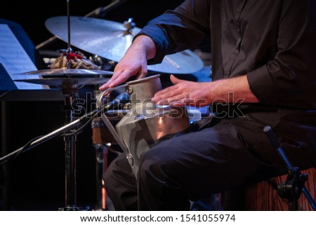 hands playing a musical instrument