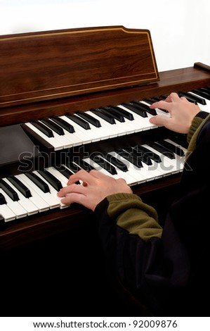 hands playing musical keyboard instrument of electronic organ .