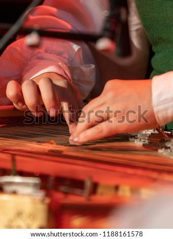 Hands playing on Kokle, a latvian plucked string instrument belonging to the Baltic box zither family #1188161578