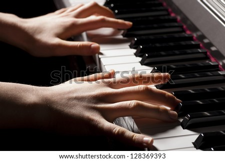 hands playing the piano #128369393