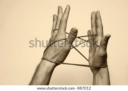 Hands playing with rope, symbolising connectivity, friendship, strong bonds. Sepia toning.