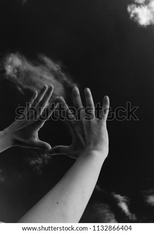 hands pointing toward sky #1132866404