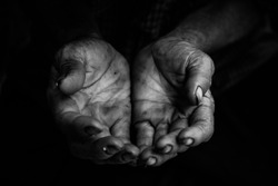 hands poor old man or beggar begging you for help sitting at dirty slum. concept for poverty or hunger people,human Rights,donate and charity,background text.black and white tone