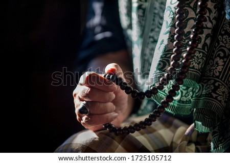 Hands praying,Crop hand of muslim man holding rosary or tasbih. shallow dept of field. Stock photo ©