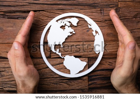 Hands Protecting Earth Icon In Environmental Protection Concept