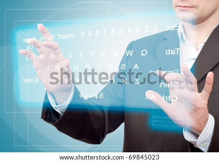 Hands pushing a button on a touch screen