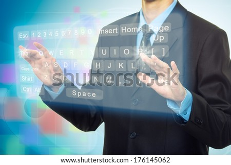 Hands pushing a button on a virtual touch screen