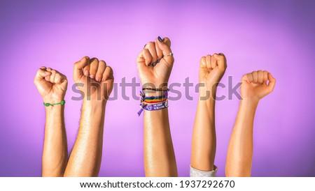 hands raised as a sign of gender equality, no more gender violence and gender equality