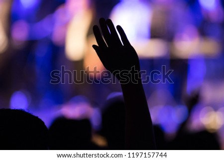 Hands raised for praise and worship christian concert with submissive and joyful