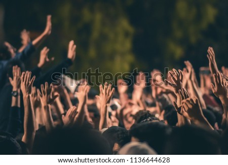 Hands raised in protest
