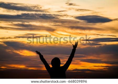 Hands raised like praying or worshiping Stock photo ©