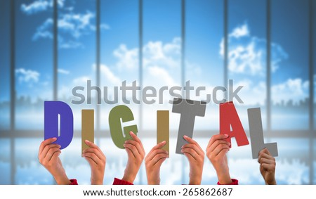hands showing digital against room with large window looking on city skyline