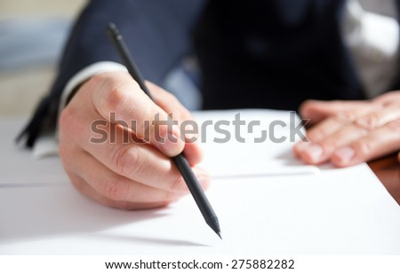 Hands signing business documents.Signing papers. Lawyer, realtor, businessman sign documents.