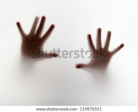 hands silhouette behind a  transparent  paper