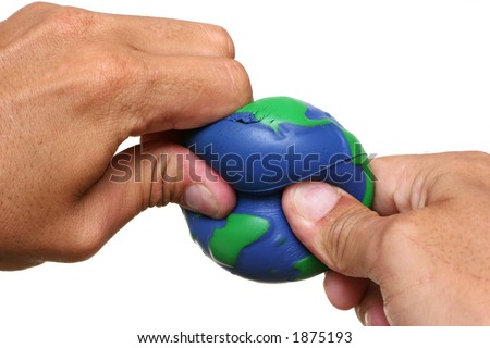 Hands squeezing Earth over a white background