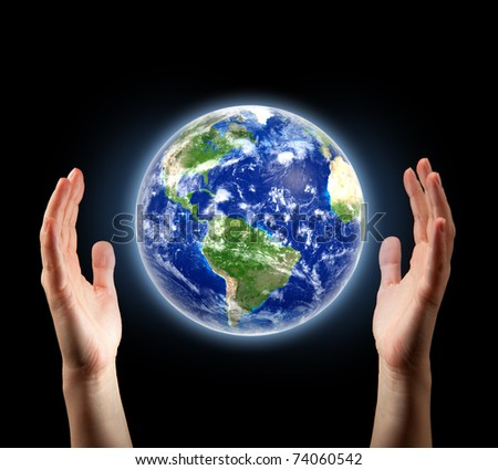 hands surrounding planet Earth