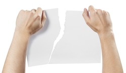 Hands tearing a piece of paper, isolated on white background