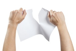 Hands tearing a sheet of white paper in half, isolated on white background