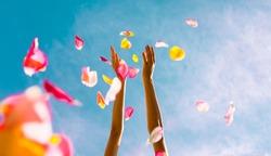 Hands throwing rose petals.  (Celebration concept)