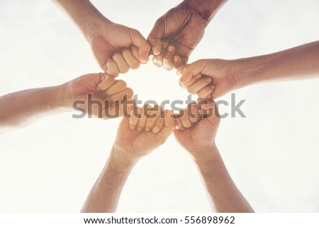 Hands together Concept. Group of young Multiethnic Collaboration Teamwork Standing Hands Together as a Circle. Unified Community Friendship with Team Support. #556898962