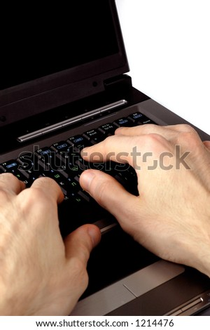 Hands typing on a laptop computer keyboard