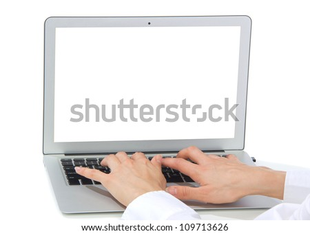 Hands typing on keyboard computer laptop with blank copy-space screen  in an office at a workplace isolated on a white background