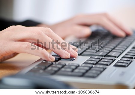 Hands typing on the keyboard
