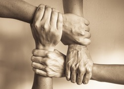 Hands united helping each other. In unity there is strength concept.