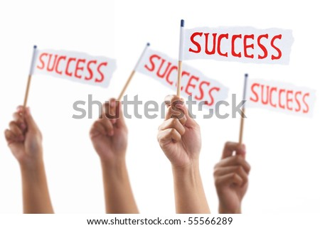 Hands uprising and holding success flag, shot against white background