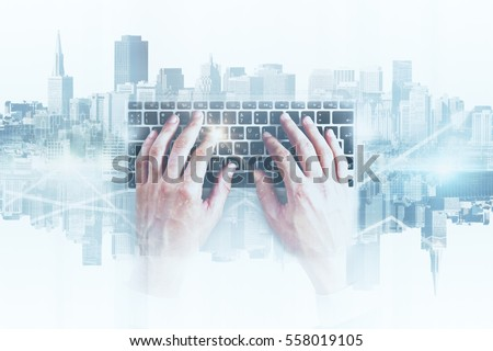 Hands using abstract keyboard on white city background. Technology concept. Double exposure