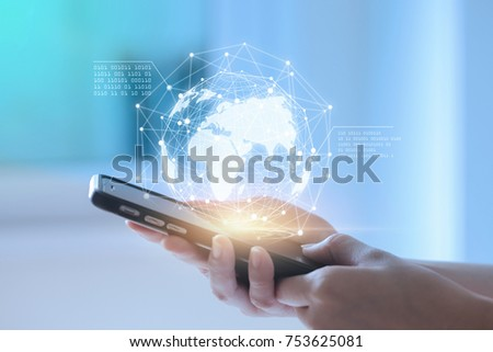 Hands using telephone device display business data. Mobile Technology concept. #753625081