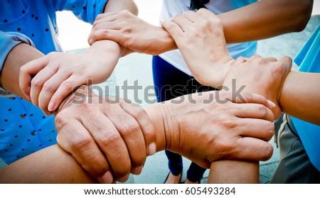 Hands were a collaboration concept of teamwork,teamwork concept #605493284
