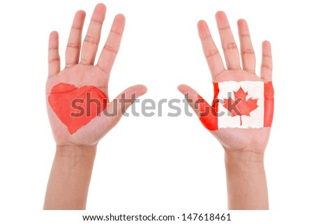 Hands with a painted heart and canadian flag, i love canada concept, isolated on white background