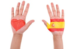 Hands with a painted heart and spanish flag, i love spain concept, isolated on white background