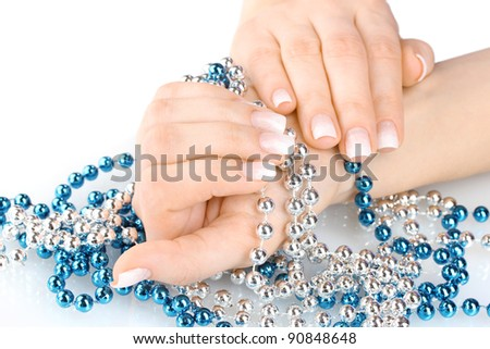 hands with beautiful winter design and beads isolated on white